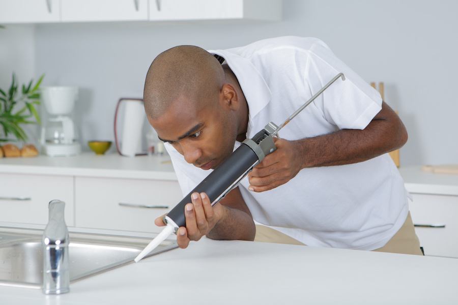 man using sealant