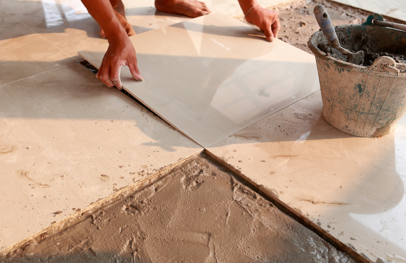 Person laying ceramic tiles