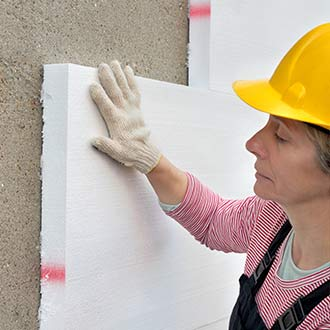 photo of worker installing rigid insulation